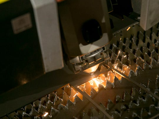 A laser recently acquired by White Mule in Ontraio cuts a part out of eighth inch stainless steel.