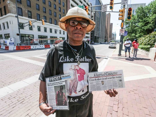 Lynn Dandridge, the father of murdered North Side football coach and Fort Wayne Community Schools teacher Terrance Lynn Miles attends the City-Wide End the Violence Rally, where attendees marched from the Indiana Statehouse to Monument Circle in Indianapolis on Saturday June 3, 2017.