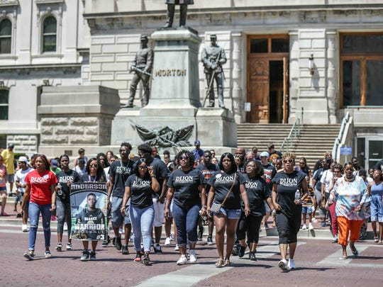 Marchers chant and hold signs of murdered loved ones during the City-Wide End the Violence Rally where attendees marched from the Indiana Statehouse to Monument Circle in Indianapolis on Saturday June 3, 2017. Many marchers wore shirts in remembrance of Warren Central student-athlete Dijon Anderson who was shot and killed with Angel Mejia-Alfaro.