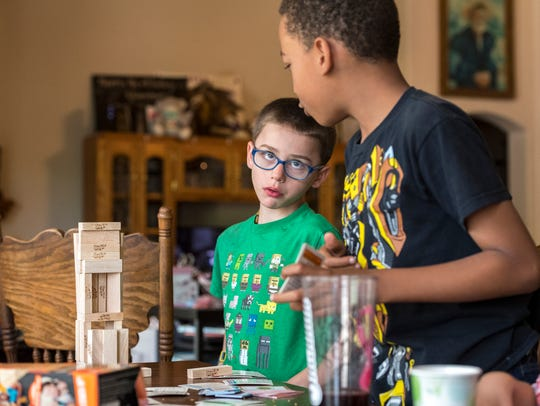 Olly Ajluni, 7, left, plays with his cousin Noah Maupin,