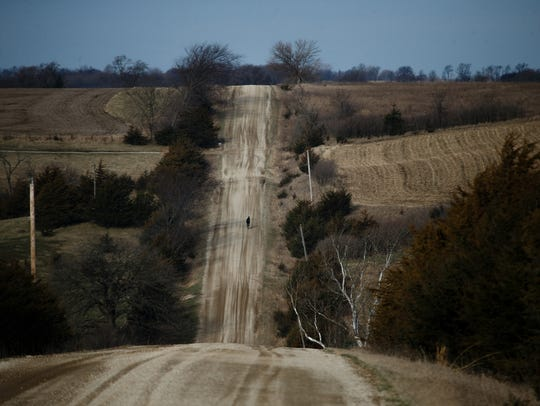 Sarah Cooper travels down a back road during a five-hour