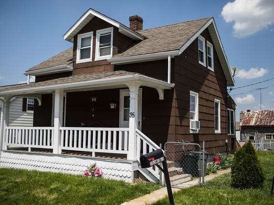 This May 18, 2017 photo, shows the home of Talisha Powell in Littlestown, Pa., the scene of a murder-suicide of her daughter and husband in 2016. Powell survived but still struggles with the memory of the night when her husband Donald Powell Jr., 36, shot her in the shoulder and then shot and killed their daughter, Codie, 9, before turning the gun on himself. She still lives in the family home. (Sean Simmers/PennLive.com via AP)