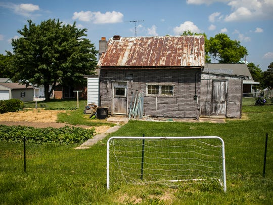 This May 18, 2017 photo, shows a soccer net in the back yard of Talisha Powell's home in Littlestown, Pa. In 2016. Powell's husband Donald Powell Jr., 36, shot her in the shoulder and then shot and killed their daughter, Codie Powell, 9, before turning the gun on himself. (Sean Simmers/PennLive.com via AP)