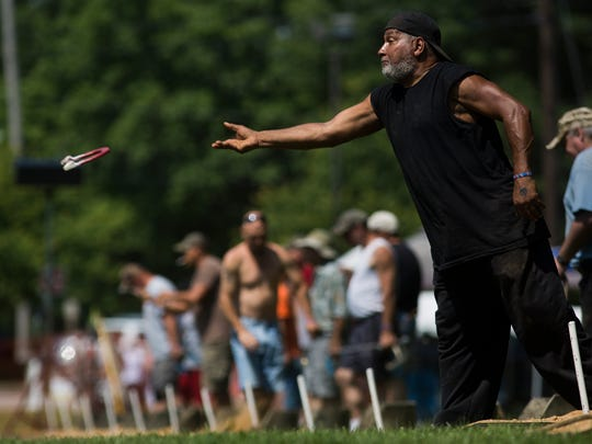 Bill Middleton, 61, of Coatesville, right, throws a horseshoe. Participants compete in Pitching 4 Patriots, a horseshoe pitching tournament fundraiser benefiting York County veterans, hosted by the York County Veterans Outreach at Veterans Memorial Park in York, Saturday, June 10, 2017.