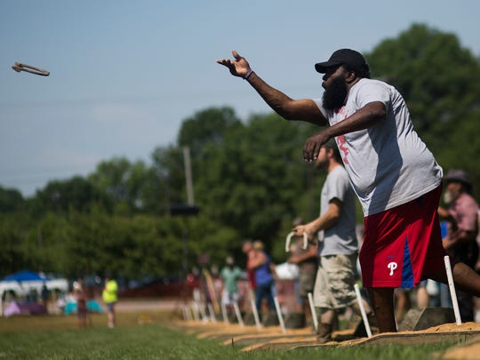 Roger Cannon, 49, of Coatesville, right, throws a horseshoe. Participants compete in Pitching 4 Patriots, a horseshoe pitching tournament fundraiser benefiting York County veterans, hosted by the York County Veterans Outreach at Veterans Memorial Park in York, Saturday, June 10, 2017.