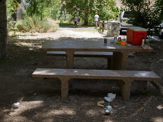 Trash lies on the ground next to a picnic table at Whitewater Preserve, Saturday, June 10, 2017.