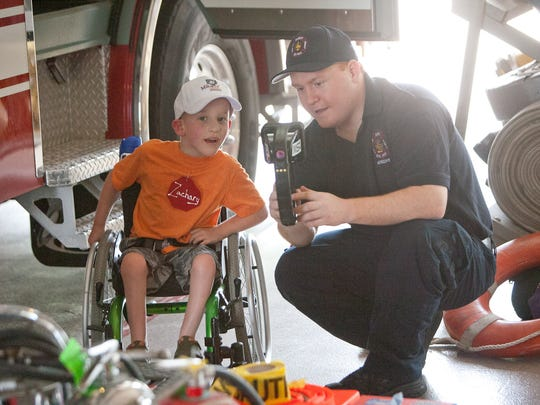 Firefighter Daniel Knox shows Zachary Pleuger, 5, of Ankeny how a thermal energy camera operates. Zachary Pleuger, 5, of Ankeny, gets a demonstration of a Thermal Energy Camera from fire fighter Daniel Knox, of Ankeny, during the Ankeny Safety Town's visit to the Ankeny Fire Department on Tuesday afternoon, June 17, 2014.