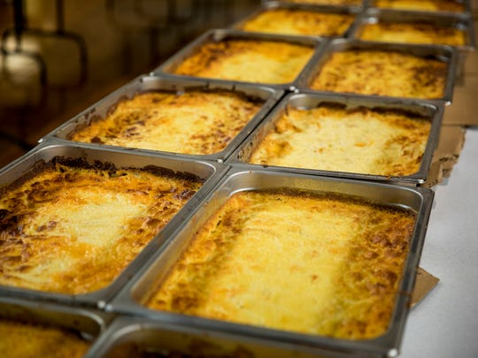 Parishioners make 88 pans of pastitsio for the Panegyri Festival at the Holy Trinity-St. Nicholas Greek Orthodox Church Monday, June 12, 2017.