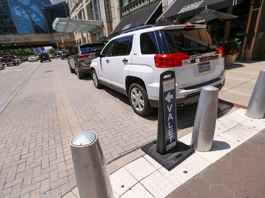 The Cultural Trail is interrupted by the valet parking area of the Conrad Hotel, downtown Indianapolis, seen on Wednesday, June 21, 2017. Pedestrians and cyclists are forced onto the sidewalk to go around valet traffic, or weave between vehicles, posing a safety concern.