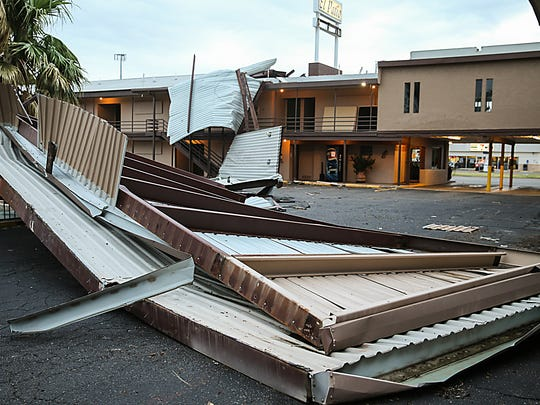 Parts of the roof of El Patio Inn on W. Beauregard Avenue came off during the severe thunderstorm Friday, June 23.