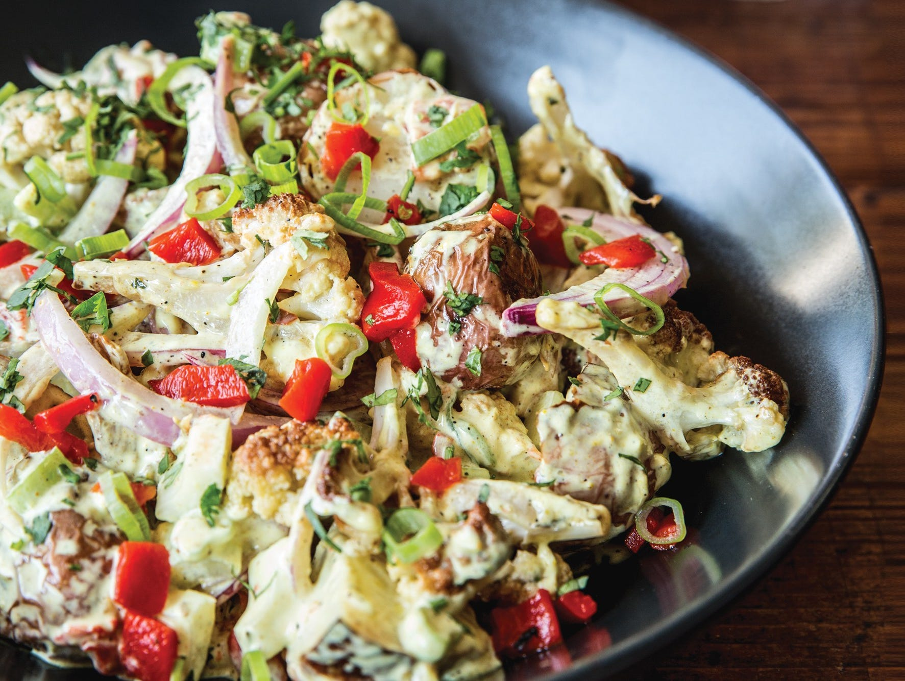 Enjoy this flavorful Curried Cauliflower & Potato Salad recipe designed by Guy Fieri!