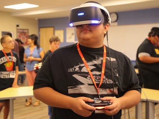 John Wesley experiences virtual reality at a summer