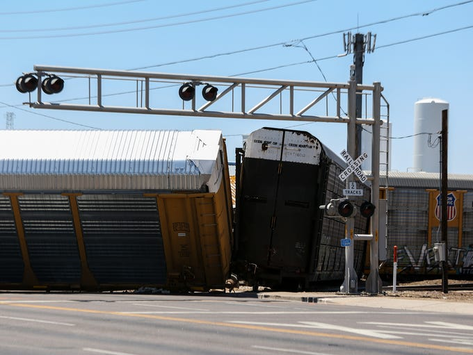 A derailed train is pictured at the intersection of