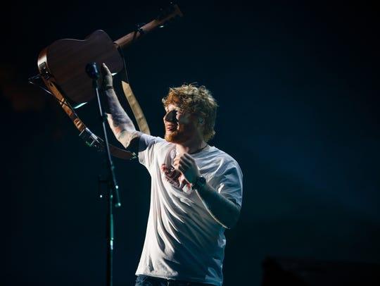 "Ed Sheeran plays during his ""Divide"" tour at Wells"