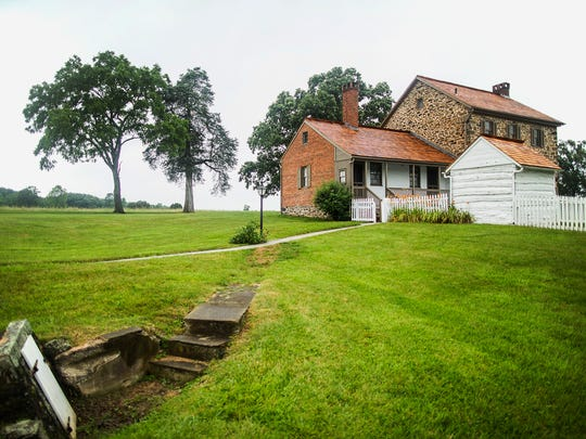 ADVANCE FOR WEEKEND EDITIONS - This June 23, 2017, photo shows the Historic Bushman House that survived the Battle of Gettysburg, Pa. For a couple hundred dollars, you can spend the night in the house. (Sean Simmers/PennLive.com via AP)