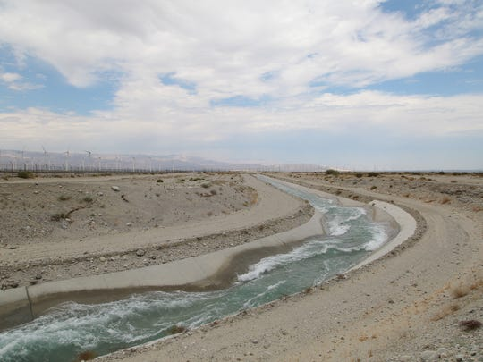 Water from the Colorado River rushes into a groundwater recharge facility near Palm Springs, Calif., Wed. July, 5, 2017.