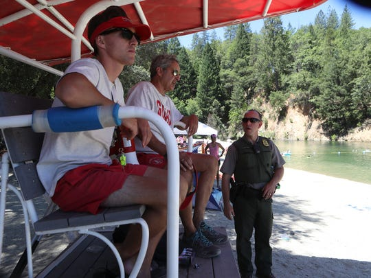 Acting Chief Ranger Dave Keltner, from right, talks