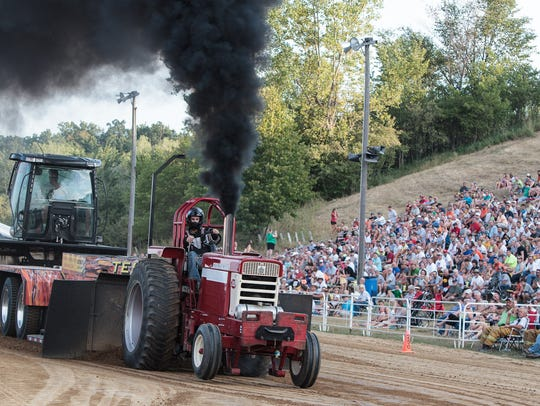 A tractor pull at the Johnson County Fair  on July