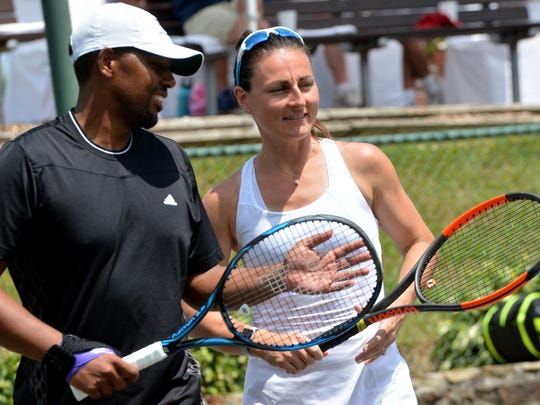 Punch Maleka, left, and Delia Mask talk between points during the Mixed Doubles Charity Classic championship match at the Country Club of York last year. Both Maleka and Mask will compete in this year's tournament, but they will not be partners. YORK DISPATCH FILE PHOTO