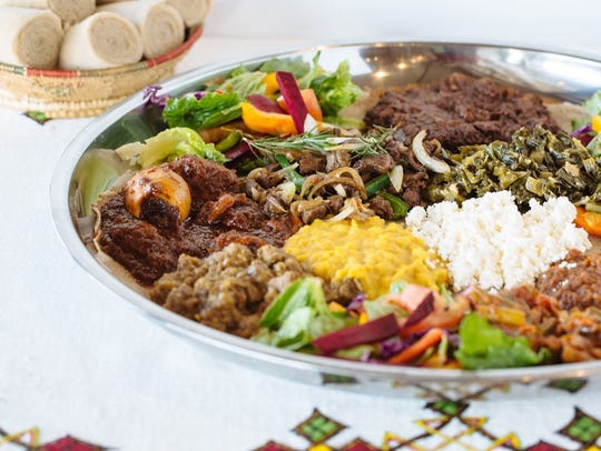 Cafe Lalibela serves dishes like the Lalibela Exclusive, which feeds four and is loaded with traditional Ethiopian favorites, including spicy chicken stew, collard greens and savory lentils.
