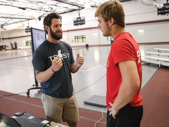 Sparta Science representative Matt Long goes over New