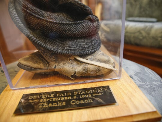 Devere Fair wore the same outfit, including this hat and these shoes, for every football game he coached at Wabash and Decatur Central — 103 games. His wife, Jane, handwashed the clothes so they wouldn't be worn out by a washing machine. Friend Terry Lingner made the memorial box for Fair.