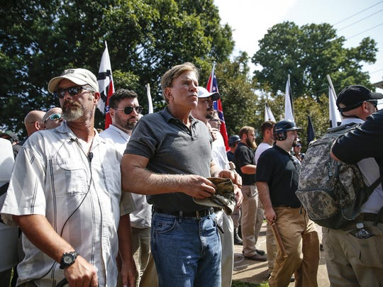 """White nationalist David Duke makes his way onto the grounds of Emancipation Park, formerly known as Lee Park, during a """"Unite the Right"""" rally in Charlottesville, Va., on Saturday, Aug. 12, 2017."""