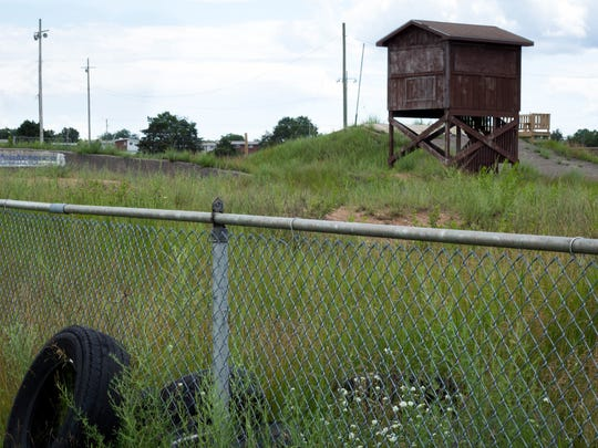 Remnants of the old Wurtsmith Air Force Base offer hints of military life from nearly three decades ago. Now, residents in Oscada, Mich., are left with contaminated water from years of operations.