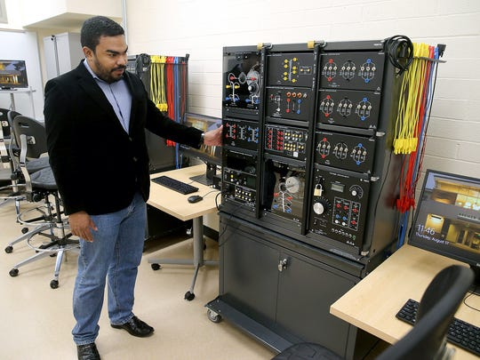 Javier Guerrero, a clinical assistant professor for the WSU electrical engineering program at Olympic College, stands in the program's new lab, built in the former CenCom building on Warren Avenue in Bremerton.