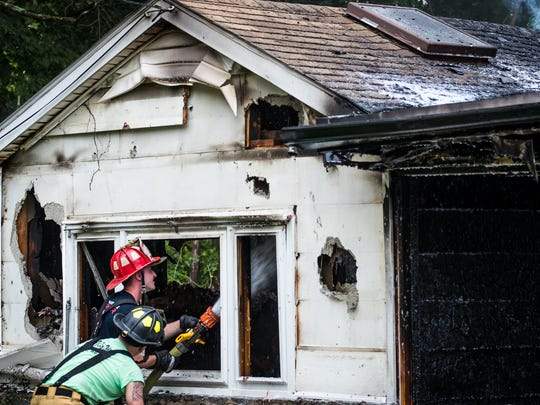 Firefighters work at the scene of a third-alarm house fire on the 4200 block of Old Harrisburg Road on Friday, Aug. 18, 2017 in Butler Township. The fire, which fully engulfed the house, killed a dog and sent one firefighter to the hospital for smoke inhalation. The homeowner was not home at the time of the fire, and the cause is still undetermined.