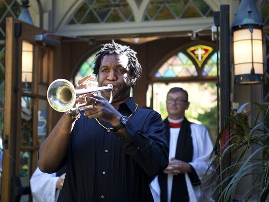 Herb Smith leads a processional out of Christ Episcopal Church in Pittsford following the funeral service for Dr. J. Daniel Subtelny on Saturday, September 27, 2014. A jazz band and mardi gras beads included in the procession set a celebratory mood to reflect Dr. Subtelny's love for life.