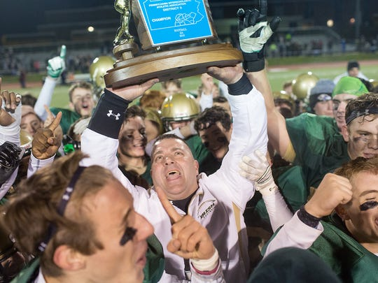 York Catholic head coach Eric Depew celebrates his team's District 3 championship in 2016.