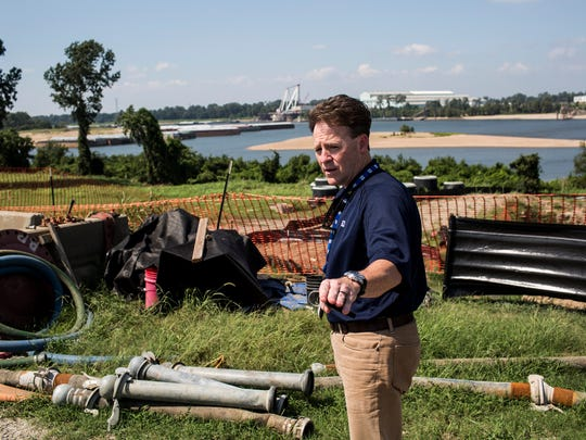 August 22, 2017 - Scott Turnbow, general manager of strategy and engineering with the Tennessee Valley Authority, stands near a sewage pipe that runs underneath the Allen Fossil Plant property near the monitoring well that recorded high levels of arsenic. Tennessee Valley Authority is installing new wells at the Allen Fossil Plant to check for contamination.