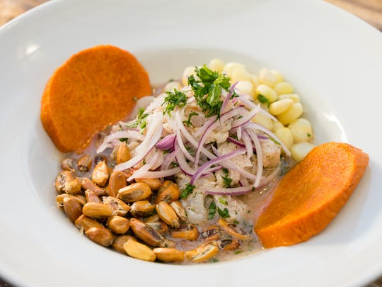 Ceviche Mixto A spicy dish of mixed seafood, cured