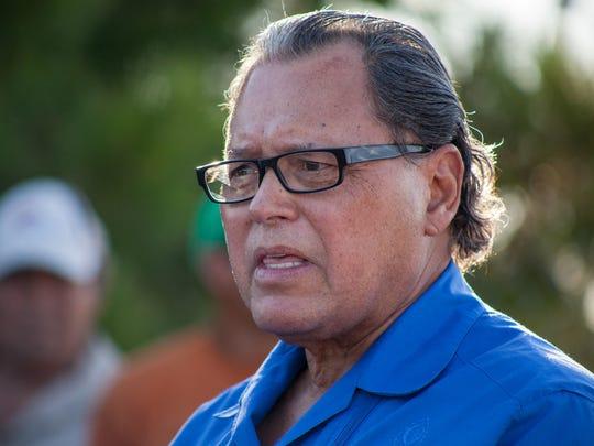 Texas State Sen. Jose Rodriguez speaks to residents