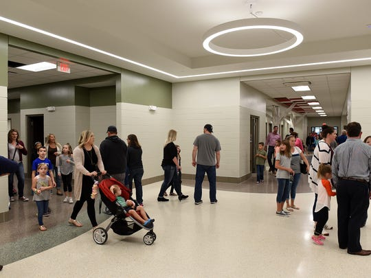 Visitors stroll through the brand-new hallways of