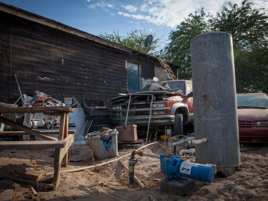 """""""Before, all of this used to be a dump. If there was sewage and potable water, it would be all right,"""" Araceli Silva said. Her sons drilled and installed a well in the backyard of her home in Wall Lane, Ariz."""