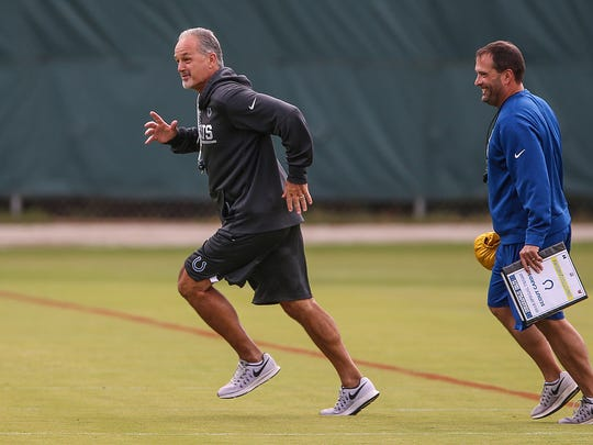 Indianapolis Colts head coach Chuck Pagano smiles while running during drills at their afternoon practice at the Colts complex on west 56th street, Indianapolis, Thursday, Sept. 7, 2017.