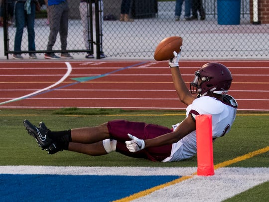 Mechanicsburg's Jermaine Hull (1) lands in the end zone for a touchdown during the first half of a game between Mechanicsburg and Spring Grove on Friday, Sept. 8, 2017 at Spring Grove High School.