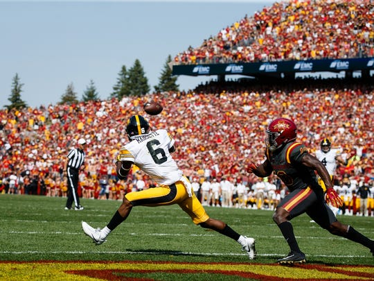 Iowa's Ihmir Smith-Marsette (6) catches a pass in the end zone during the overtime of the Cy-Hawk football game at Jack Trice Stadium on Saturday, Sept. 9, 2017, in Ames. The catch won the game for the Hawkeyes 44-41.