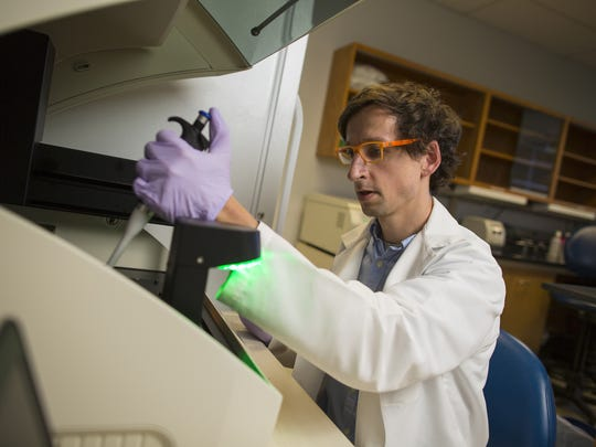 Dr. Carl Koschmann, a pediatric oncologist and researcher at the University of Michigan C.S. Mott Children's Hospital in Ann Arbor, works in the lab.