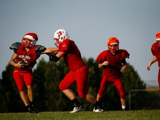 North Tama senior Cory Kennedy (78) drills with his team on Tuesday, Sept. 12, 2017, in Traer. Kennedy is one of Class AÕs best two-way linemen. Instead of spending his last high school summer with friends he followed his families tradition of service and went into the National Guard.