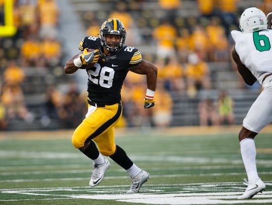 Iowa's Toren Young (28) rushes during their football