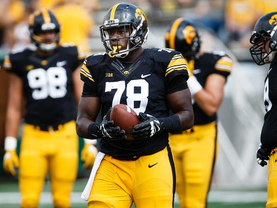 Iowa's James Daniels (78) warms up before taking on North Texas at Kinnick Stadium on Saturday, Sept. 16, 2017, in Iowa City.