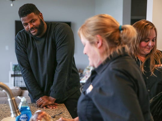 From left, Indianapolis Colt Johnathan Hankins chats with personal chefs Suzanne Rockwell and Christy Rieman at Hankins' home in Carmel, Ind., Monday, Sept. 12, 2017. Hankins has formed a friendship with his personal chef thanks to Ohio State ties. Hankins is a client of Chef Suzanne Catering, one of many professional athletes the company has served over the years. Chefs Suzanne Rockwell and Christy Rieman prepare and deliver meals to Hankins throughout the week, communicating with the Colts team dietician as needed.