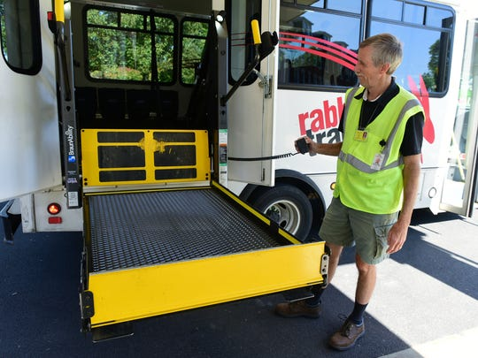 Tim Gamber, a Rabbit Transit bus driver, lowers the wheelchair lift for a disabled passenger on Wednesday, September 20, 2017 at Penn Hall, Chambersburg.