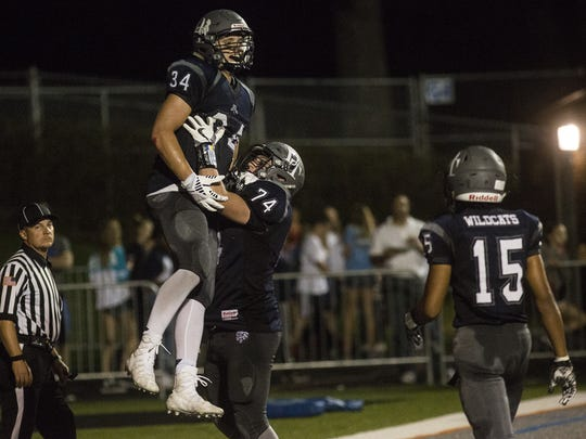 Dallastown's Benjamin Ward, left, is lifted into the air by Raymond Christas after Ward scored a touchdown. Dallastown defeats Spring Grove 52-13 in football at Dallastown Area High School, Friday, September 22, 2017.