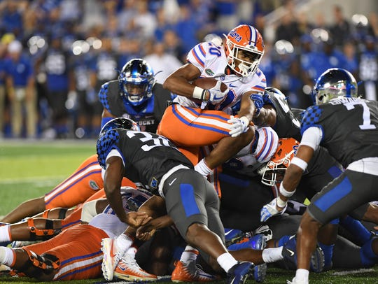 UF RB Malik Davis runs for a first down on 4th and