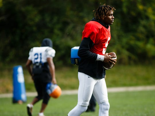 Kai Locksley jogs to a drill during Iowa Western's