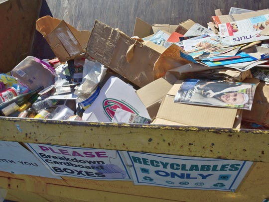Discarded items are  in a single-stream bin Wednesday,